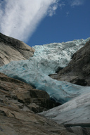 Crevasses in a glacier are the result of movement