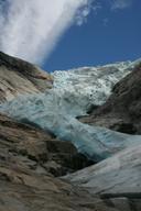Crevasses in a glacier are the result of movement