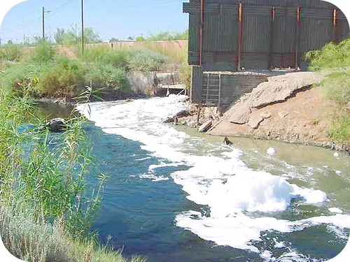 Polluted water pouring into a stream coming from a factory in Mexico