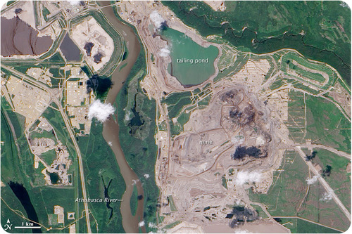 A satellite image of an oil-sands mine in Canada
