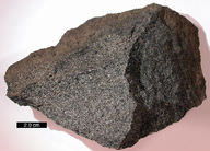 Gabbro is a dark dense rock that can be found in oceanic crust