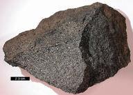 Gabbro is a dark dense rock that can be found in oceanic crust