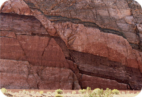 A fault cutting across bedded rocks