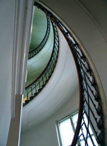 looking up into a curved stairway