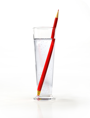 A pencil looks bent in a glass of water due to refraction