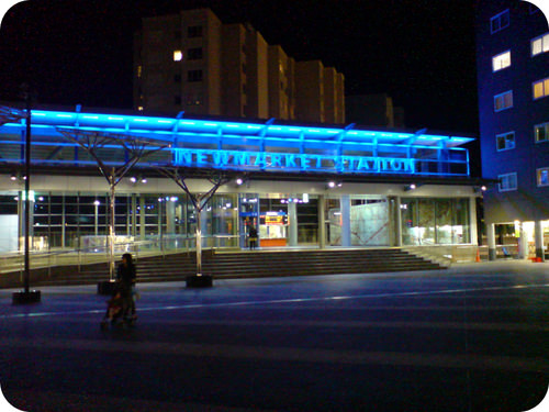 Blue neon lights on a subway station