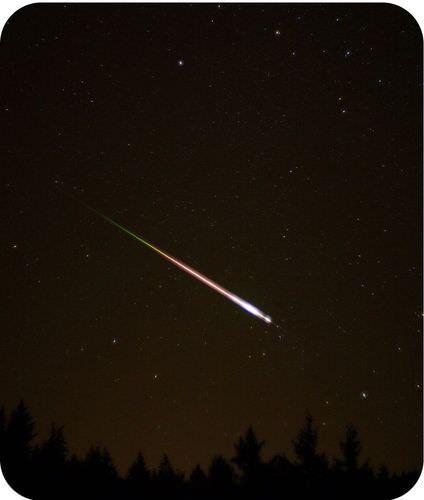 =A meteor streaks across the sky