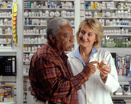 Pharmacist and elderly patient