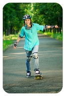 Skateboarder pushing off the ground