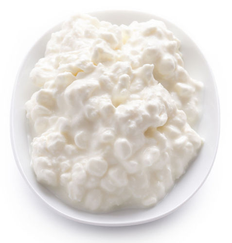 Adding acid to milk to form cottage cheese is a chemical reaction