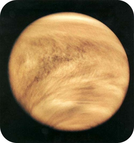 An ultraviolet image of Venus, showing a thick layer of clouds