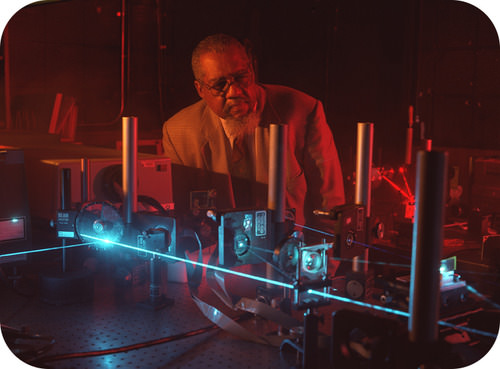 Don Frazier, a NASA chemist, conducting an experiment using a laser imaging system
