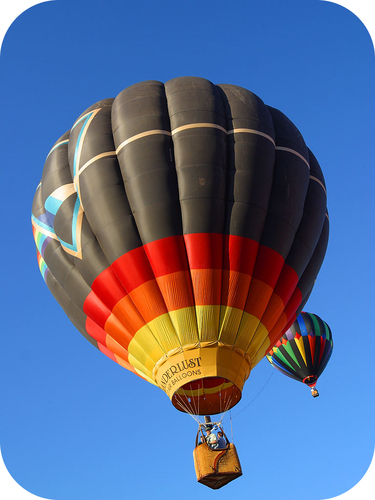 Hot air balloons require gas law and buoyancy calculations
