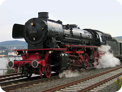 A steam train converts free energy into mechanical energy