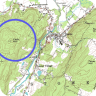 Concentric circles on a topographic map indicate a hill