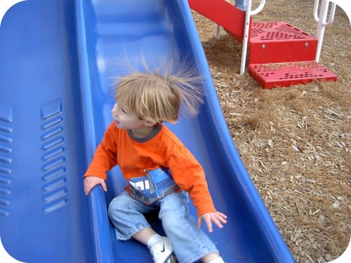Child with hair standing up due to static electricity