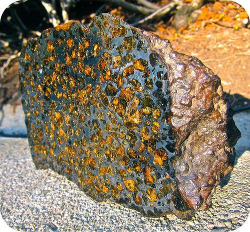 This meteorite contains silica minerals and iron-nickel, and is like the material is like the boundary between Earth's core and mantle