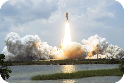 A space shuttle, such as the Atlantis, must accelerate to 28,968 km/h to escape from Earth's orbit
