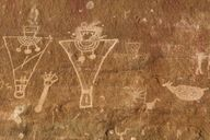 Petroglyphs carved into desert varnish