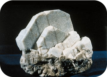 An example of a triclinic crystal is microcline
