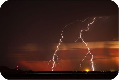 Lightning with an Arizona sunset background