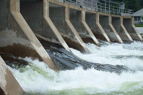 Water flowing through a dam