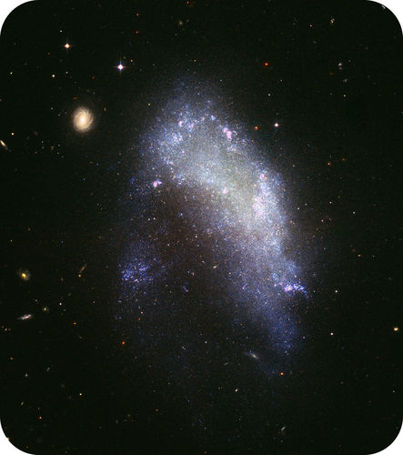 This galaxy is an irregular galaxy that is neither spiral nor elliptical