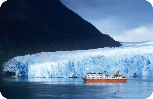 Boat sailing near St. Raphael glacier, in Southern Chile