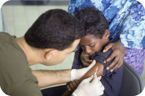 A young student receiving a vaccination