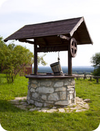 This old water well uses human muscle power to bring water to the surface
