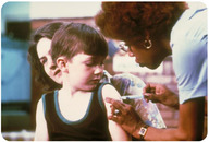 Receiving a vaccination.