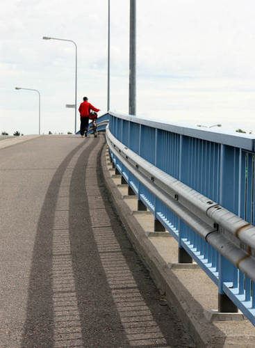 walking a bicycle across the bridge