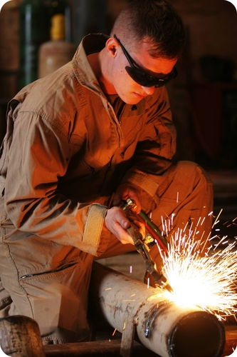 The heat generated by an acetylene torch is best calculated using Hess's Law