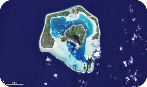 The remnants of a volcano are surrounded by the circular reef