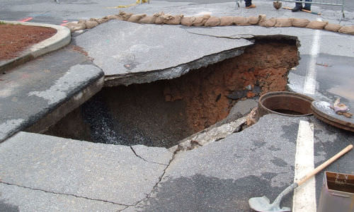 A sinkhole in a parking lot
