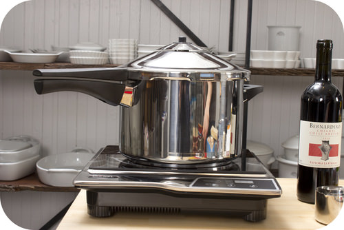 A pressure cooker increases the boiling point of water, which allows for faster cooking