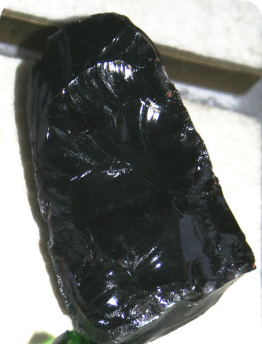 This mineral formed a smooth, curved surface when it fractured