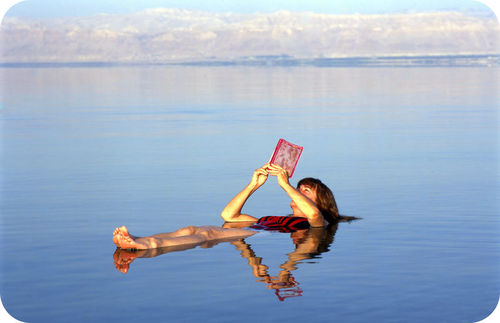 Woman floating on the Dead Sea