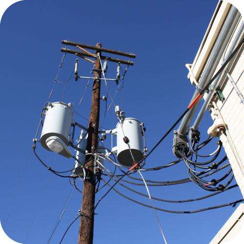 Power transformer on a pole