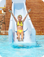 Water slides convert gravitational potential energy into kinetic energy