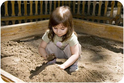 Child playing in a sandbox