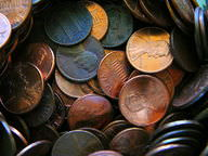 Shiny copper new pennies and dull brown old pennies
