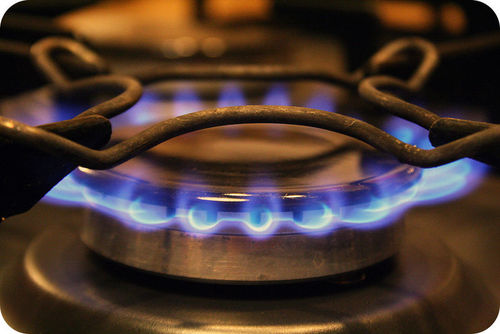 The combustion of methane powers a gas stove