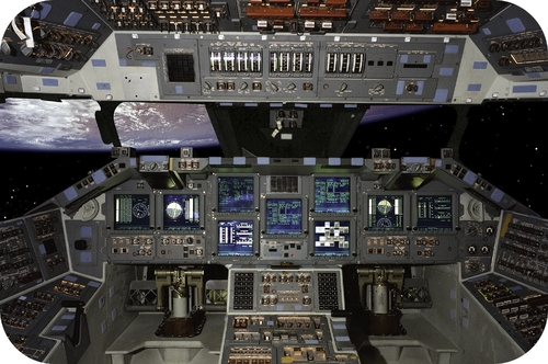 The control panel of the space shuttle Atlantis displays dozens of measurements