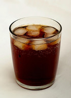 Ice cubes in cola cause the cola to lose thermal energy