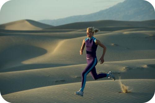 A runner on a sand dune