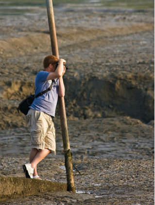 Steadying a camera by leaning on a pole