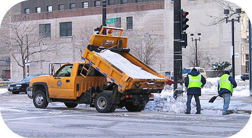 Salting roads lowers the freezing point, which will cause ice to melt more quickly