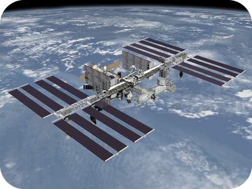 The International Space Station is a man made satellite orbiting the earth