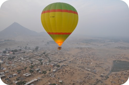 Hot air balloons float because the air inside expands as it exerts a pressure on the balloon